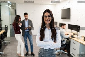 portrait of young businesswoman posing in office WEU5FBG